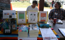 Kevin Manning the table with neighbor, author Michael J. DeValve.